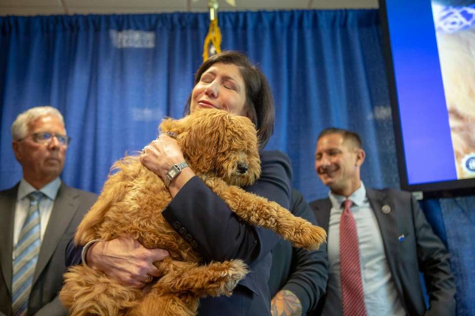 Nassau Disrrict Attorney Madeline Singas holds Bella the