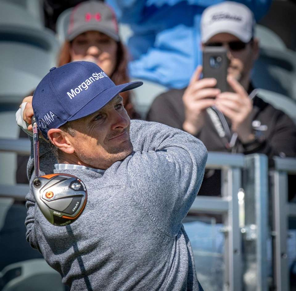 Golfer Justin Rose tees off at the first