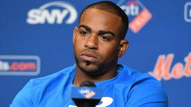 The Mets' Yoenis Cespedes looks on during a