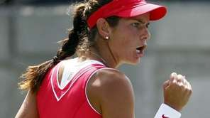 Julia Goerges of Germany reacts to a shot
