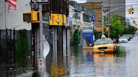 A taxi sits in flood water on Coney