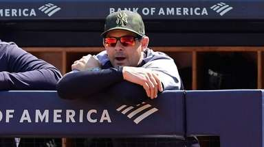 Aaron Boone of the Yankees looks on against