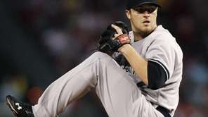 New York Yankees starting pitcher Phil Hughes winds