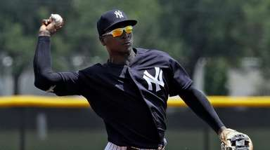 Yankees' Didi Gregorius throws the ball to first