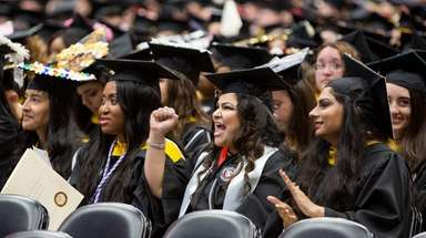 Graduates react as Molloy College President Drew Bogner