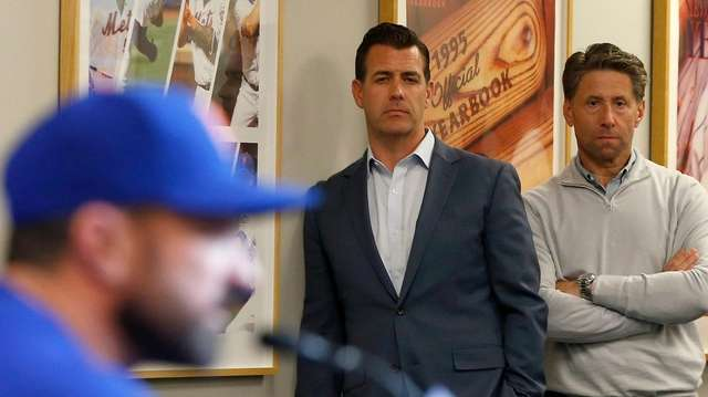 Mets general manager Brodie Van Wagenen (C) and