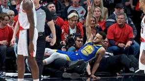 Golden State Warriors guard Stephen Curry (30) falls