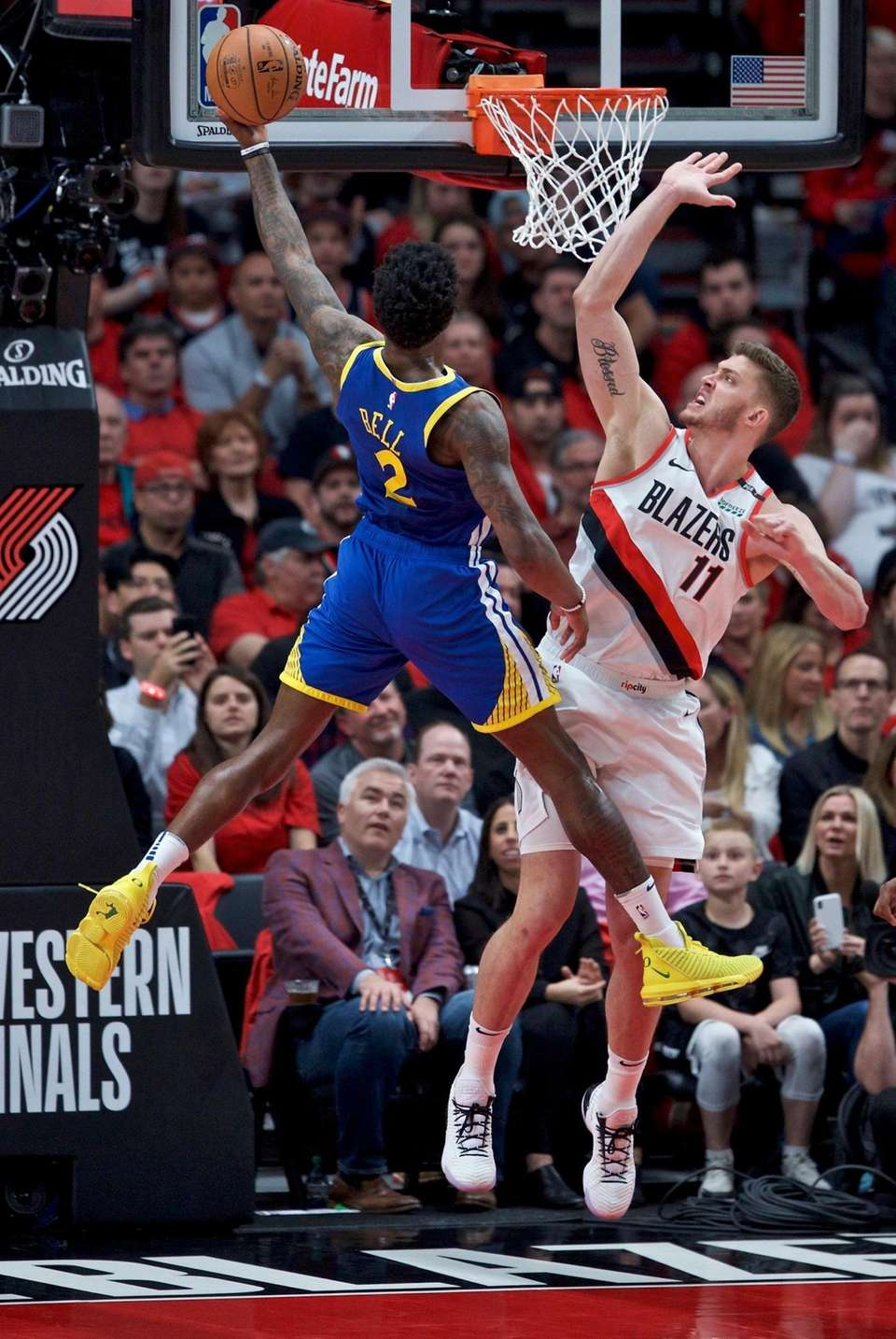 Golden State Warriors forward Jordan Bell, left, shoots