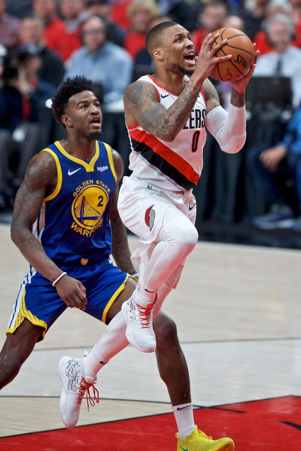Portland Trail Blazers guard Damian Lillard, right, shoots