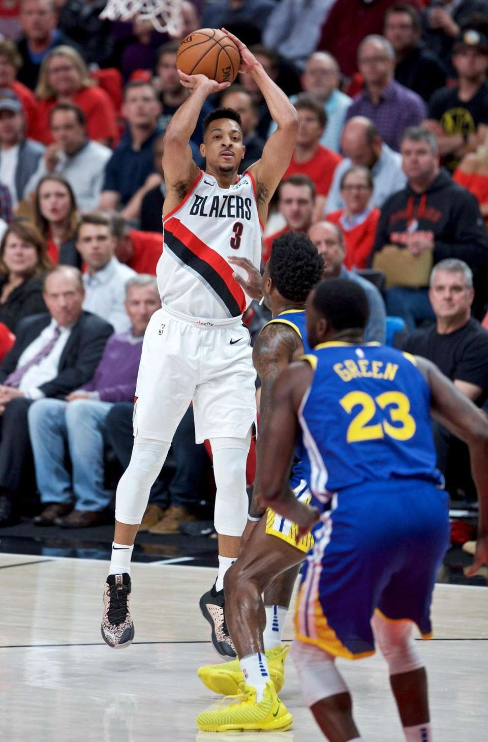 Portland Trail Blazers guard CJ McCollum, left, shoots