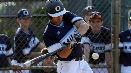Oceanside's Austin Vlahakis (14) drives in Noah Eisle