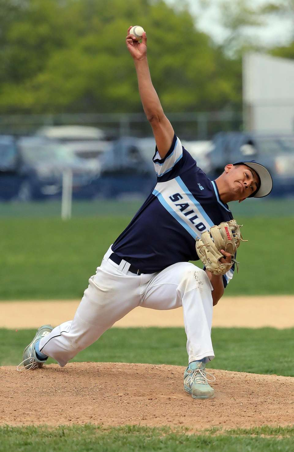 Oceanside's starting pitcher Leo Alvarez (11) delivers a