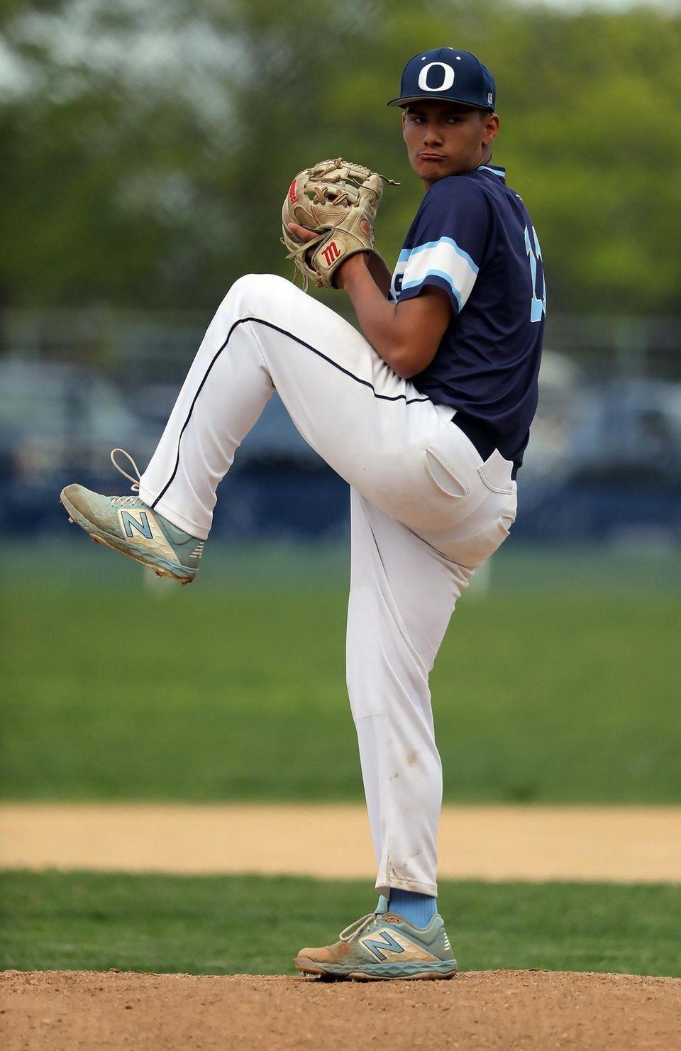 Oceanside's starting pitcher Leo Alvarez (11) winds up