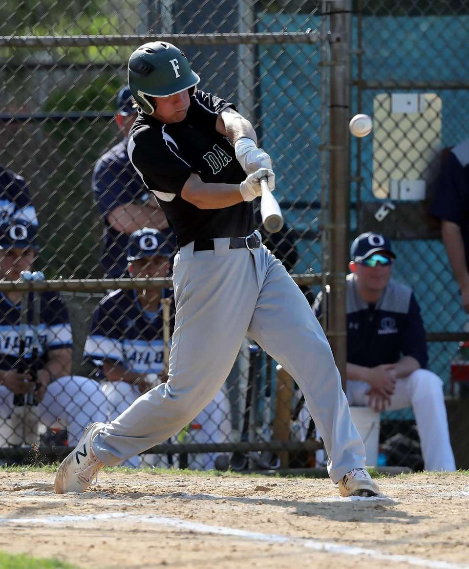 Farmingdale's Kevin Wilson sends a triple over the