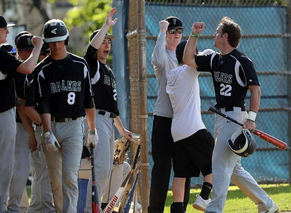Farmingdale's Kevin Wilson celebrates at home with teammates