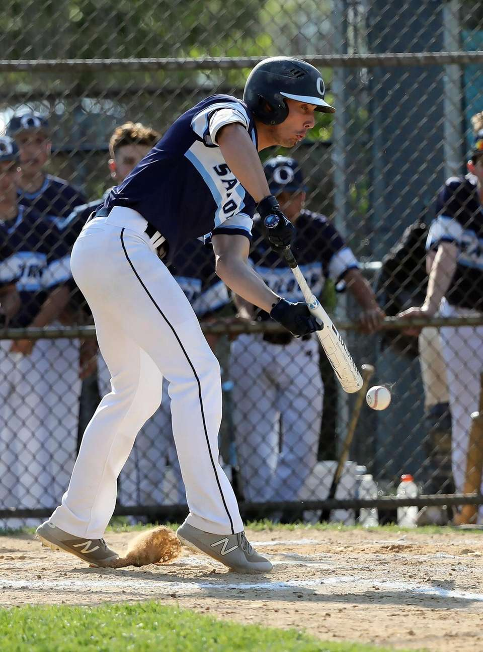 Oceanside's Jake Lazzaro (2) lays a bunt down