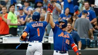 Amed Rosario #1 of the Mets celebrates his