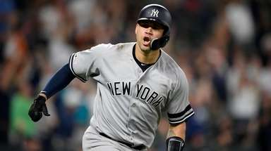 Yankees' Gary Sanchez reacts as he heads to