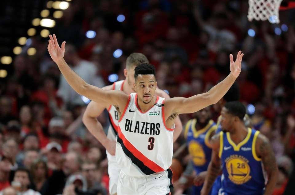Portland Trail Blazers guard CJ McCollum (3) reacts