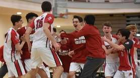 St. John the Baptist teammates celebrate after their