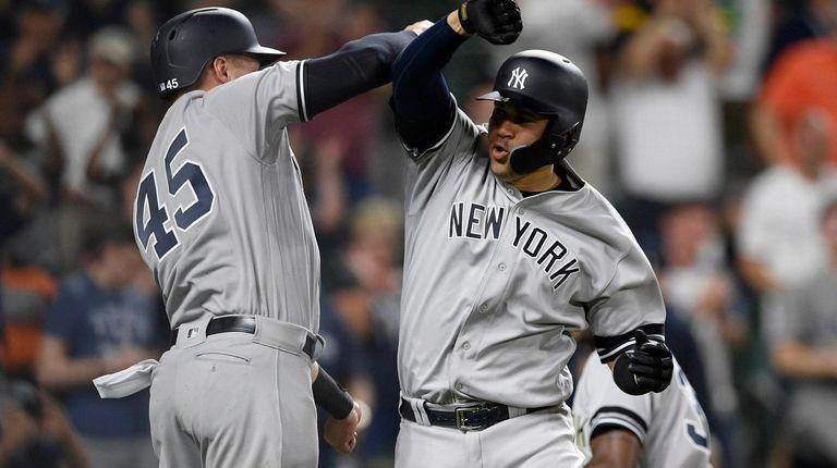 New York Yankees' Gary Sanchez, right, celebrates his