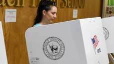 Kelly Beneventano casts her vote at Centereach High