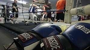Boxing gloves are seen as men train at