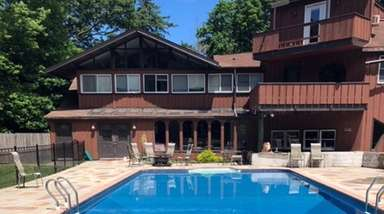 This Port Jefferson home is on a 1.73-acre