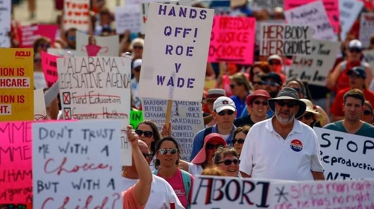 Protesters for women's rights march to the Alabama