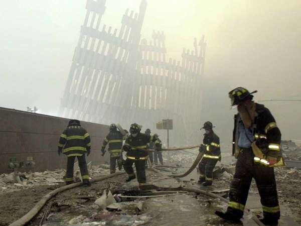 A file photo of firefighters working amid debris