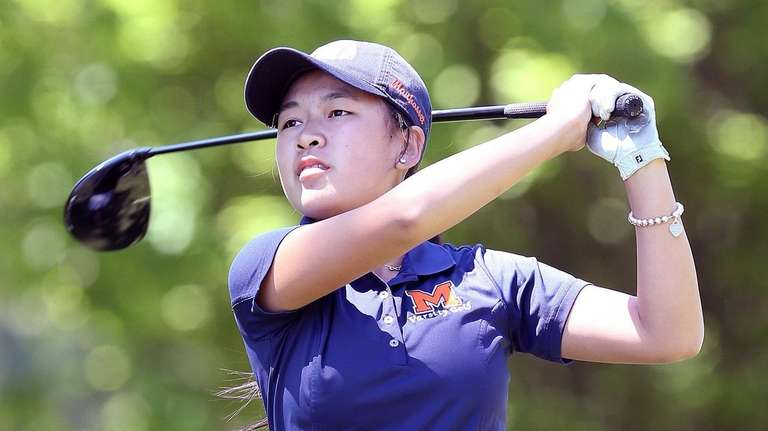 Manhasset's Lauren Chen tees off during the Nassau