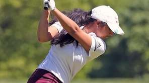 Syosset's Malini Rudra goes for the green during
