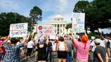 Protesters rally on Sunday at the Alabama Capitol