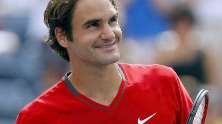 Roger Federer of Switzerland defeated Dudi Sela of