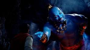 Aladdin (played by Mena Massoud) meets the larger-than-life