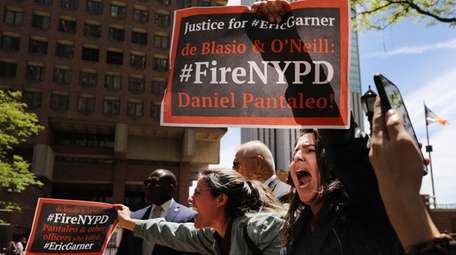 Protesters gather outside police headquarters in Manhattan on