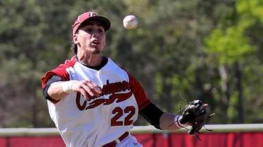 Connetquot shortstop Alex Ungar makes the leaping throw