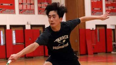 Commack's Andrew Wang with the backhand return against