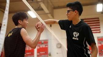 Commack's Andrew Wang (l) and Hills East's Samie