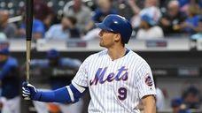Mets center fielder Brandon Nimmo sets up to