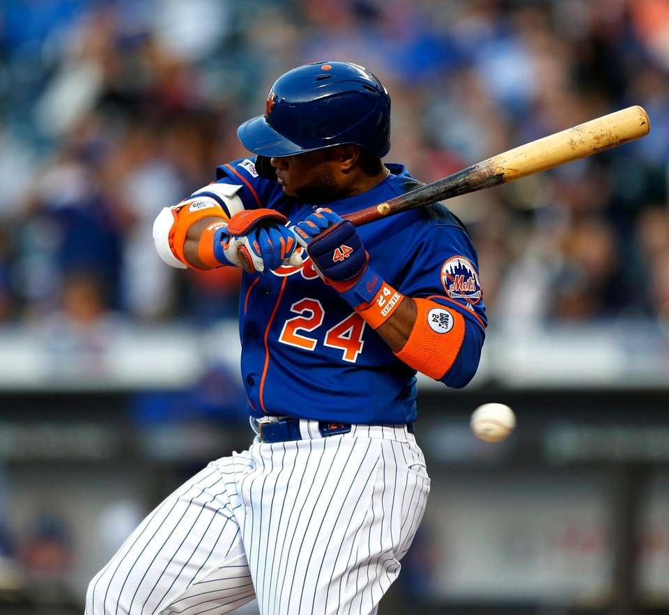 Robinson Cano of the Mets avoids a pitch