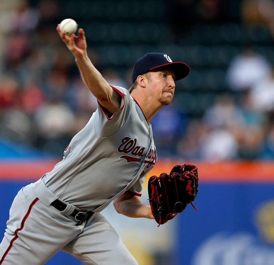 Erick Fedde #23 of the Washington Nationals pitches