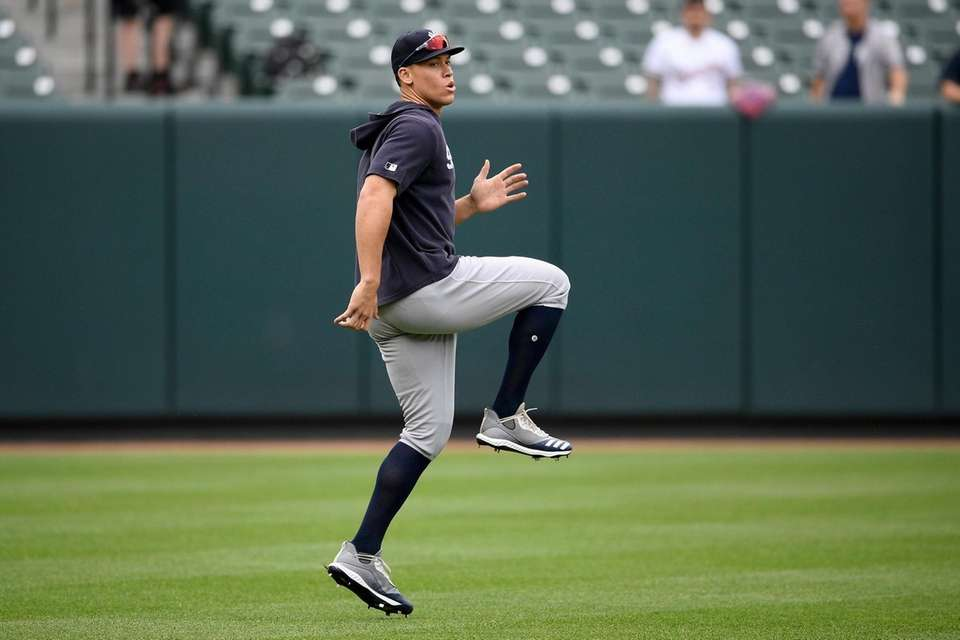 The Yankees' Aaron Judge warms up before a