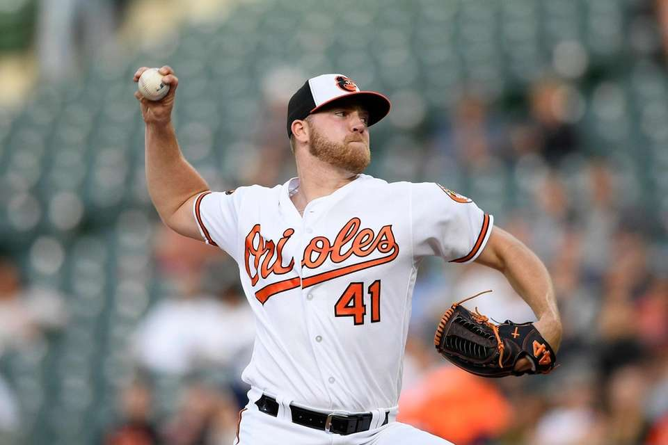 Orioles starting pitcher David Hess delivers a throws