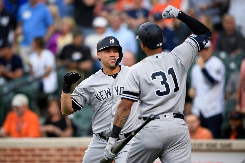 The Yankees' Gary Sanchez, left, celebrates his three-run