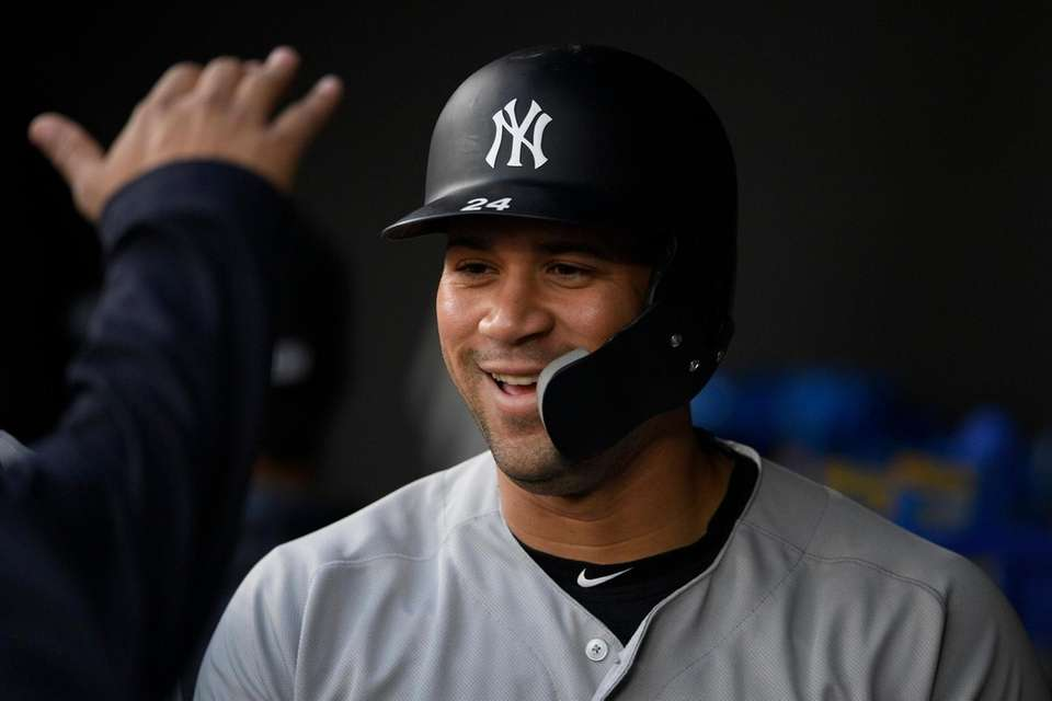 The Yankees' Gary Sanchez smiles in the dugout