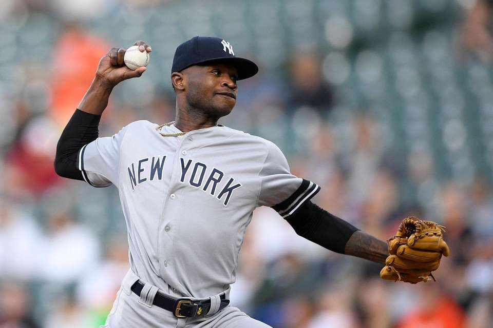 Yankees starting pitcher Domingo German delivers a pitch