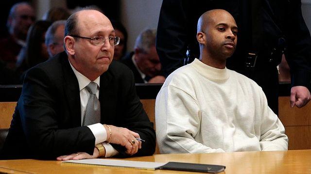 Defense attorney John Scarpa, left, with defendant Reginald