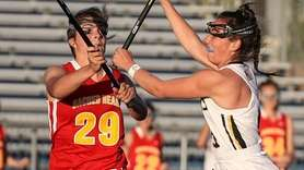 Christina Biscardi of Sacred Heart tries to break