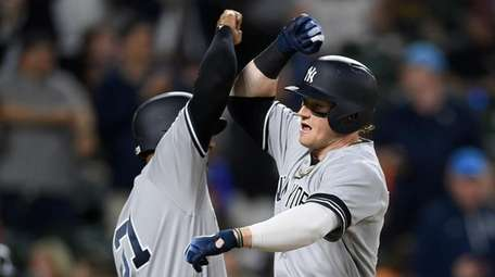The Yankees' Clint Frazier, right, celebrates his three-run